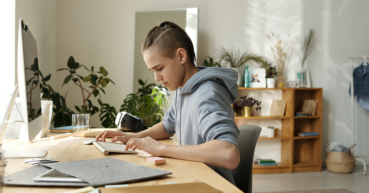 student working from home on computer